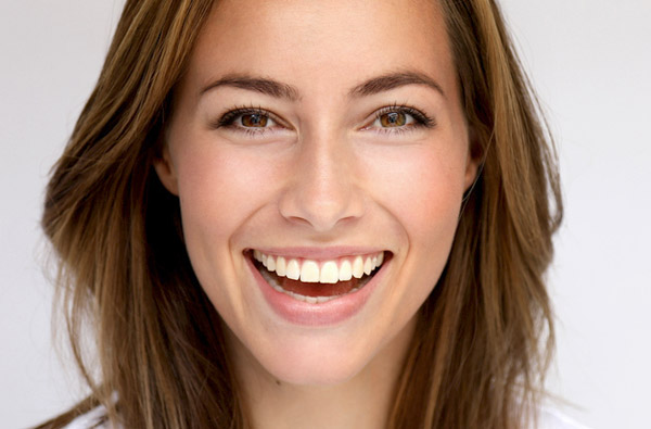 Beautiful woman smiling at Premier Periodontics and Implant Dentistry